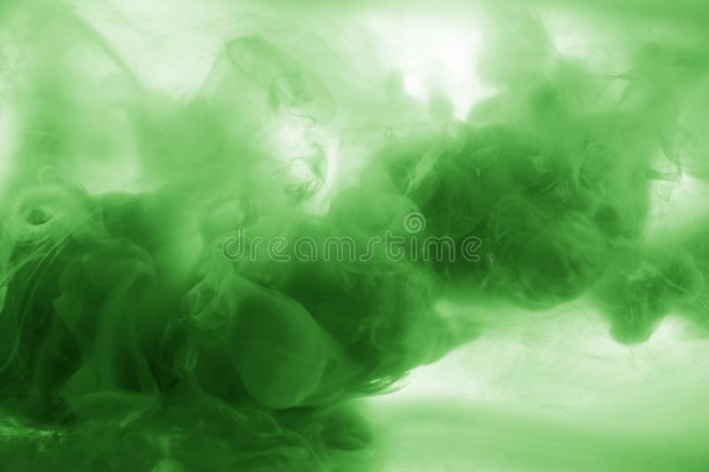 Ink in water green smoke acrylic art colorful abstract background isolated. Ink in water blau smoke acrylic art colorful abstract background i stock photos