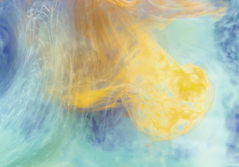 Ink in water. Yellow and blue Ink in water stock photography