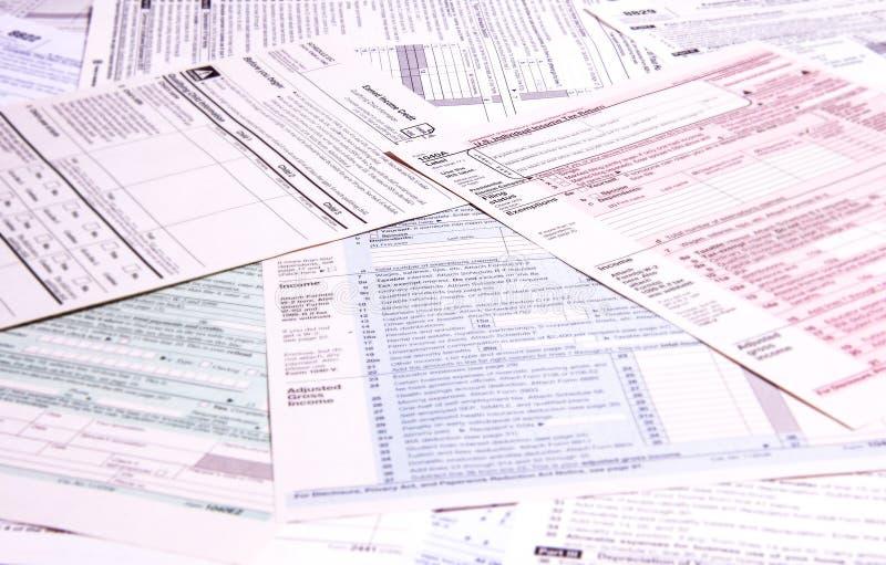Inkomstenbelastingsvormen stock fotografie
