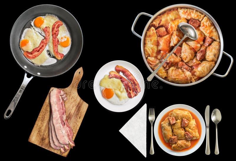 Inlagd kål välfyllda Rolls som tjänas som med Fried Eggs med bacon- och extrahjälpskinkskivor som isoleras på svart bakgrund arkivfoto
