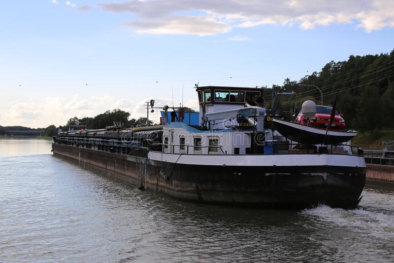 Inland freight water vessel Konrad Brand passes the lock Eckersmuehlen on the Rhine-Main-Danube Canal in Bavaria royalty free stock images