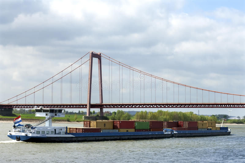 Inland shipping on river Rhine and Rhine Bridge stock image