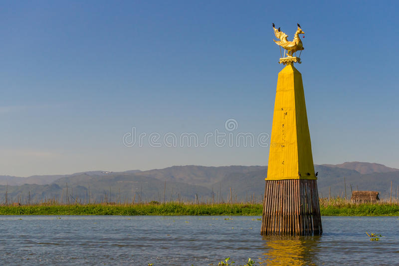Inle Lake City Limits Sign. A kind of swimming city limits sign at the Inle Lake in Myanmar at late afternoon royalty free stock photography