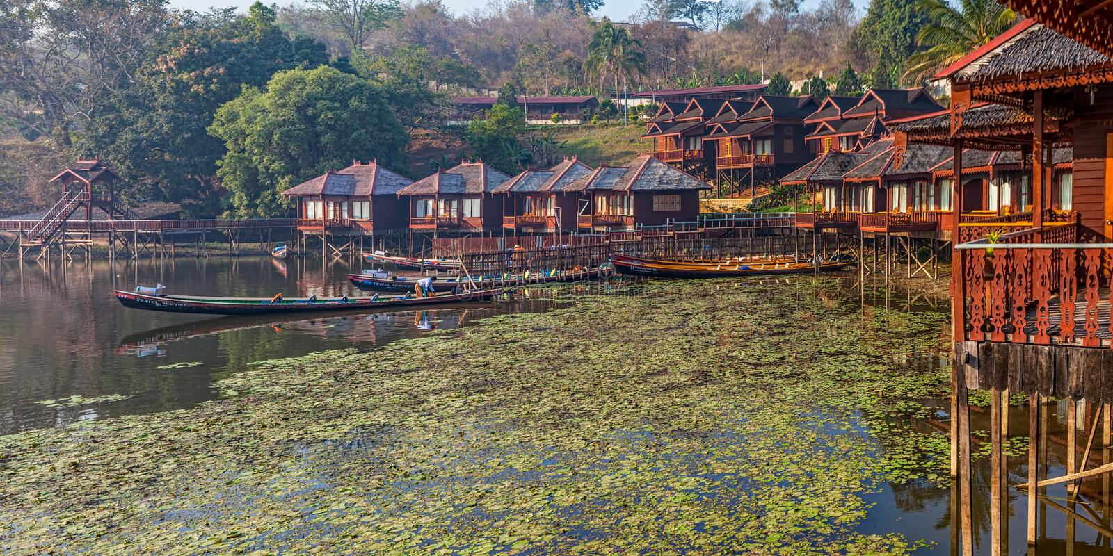Inle lake hotels. INLE LAKE, MYANMAR - FEBRUARY 27: Replica of the traditional floating village engineered as a hotel with bungalows on February 27, 2013 in Inle stock photo