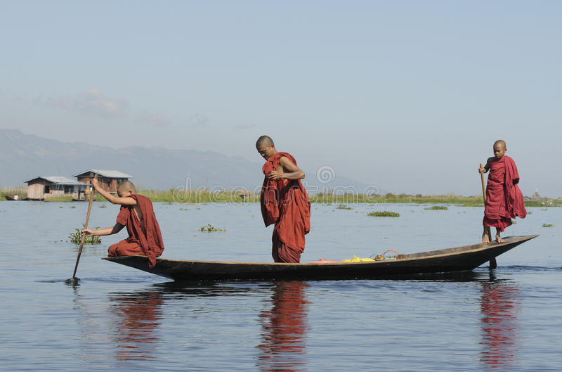 Inle Lake Life 1. Young monks with their boat on Lake Inle, Central Myanmar (former Burma royalty free stock photography