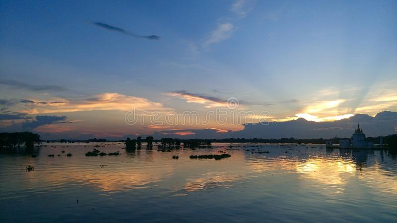 Inle lake. Myanmar Asia travel trip adventure holidays backpacker water colors views views sky clouds blue pagoda fish fishers royalty free stock image