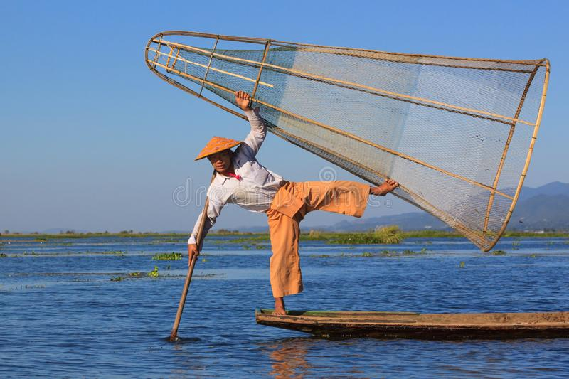 Inle Lake, Myanmar, November 20 2018 - Fisherman dressed for tourists, local fishermen don`t dress or fish like this stock photography