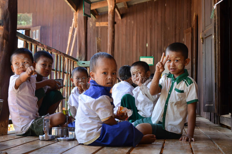 INLE LAKE, MYANMAR- SEPTEMBER 26, 2016: Unidentified local students at school, during their lunch time. Children spending time together during their break time royalty free stock photos
