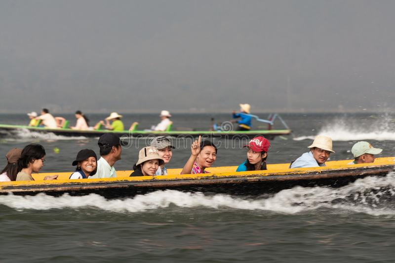 Inle, Myanmar - April 2019: Burmese people having boat ride on Inle lake. In traditional long boats, burma, tourist, holidays, transport, water, transportation royalty free stock photography