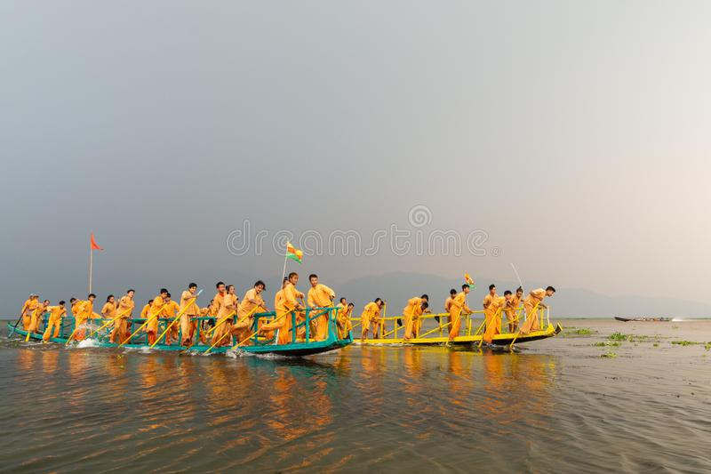 Inle, Myanmar - March 2019: Traditional Burmese leg rowing boat race competition during Phaung Dawat at Inle lake stock photos