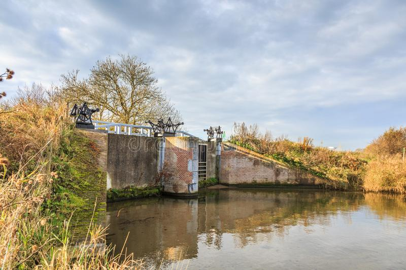 Part of Historical Dutch defense line, Nieuwe Hollandse Waterlinie,. Inlet sluice of Fort Everdingen for the flooding of the Nieuwe Hollandse Waterlinie with royalty free stock photography