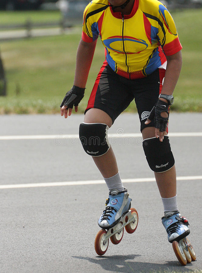 Inline Roller Blading Abstract Skates. Inline speed Roller Blading Marathon race competition event. Shows contestants jockeying for position on an oval track stock photography