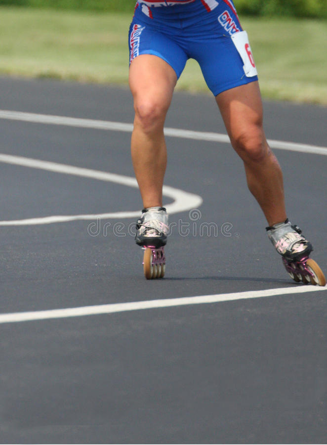 Inline Roller Blading Abstract Skates. Inline speed Roller Blading Marathon race competition event. Shows contestants jockeying for position on an oval track royalty free stock photo