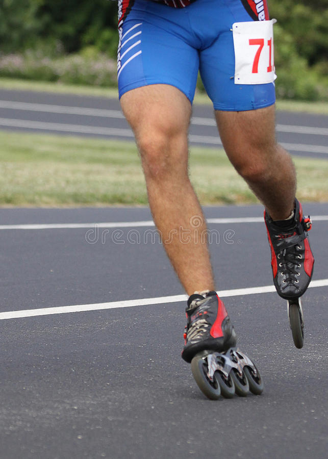 Inline Roller Blading Abstract Skates. Inline speed Roller Blading Marathon race competition event. Shows contestants jockeying for position on an oval track royalty free stock images