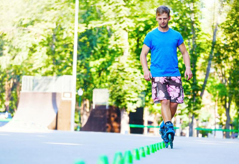 Inline roller skater on a slalom course. Close up of Inline roller skater on a slalom course royalty free stock image