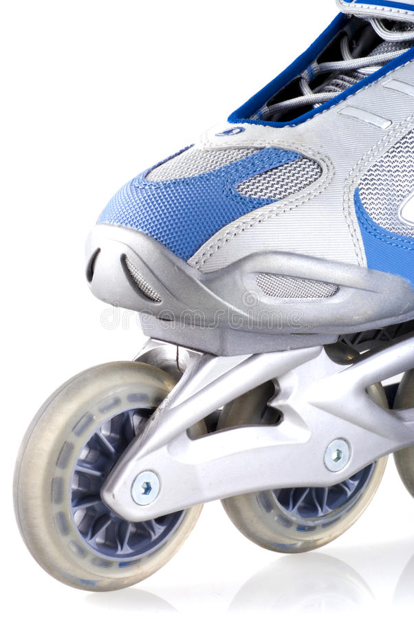 Inline skate. Close up of an inline skate, isolated on white royalty free stock photo