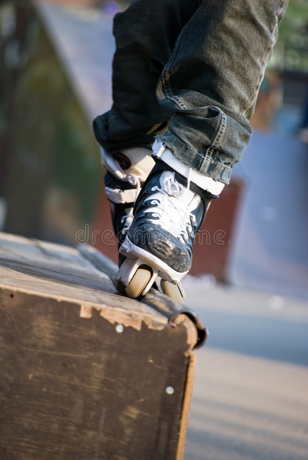 Inline skater. On the blade;focus on the skate royalty free stock photo