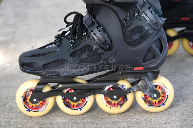 Inline skates. Roller skates with four wheels inline stock images