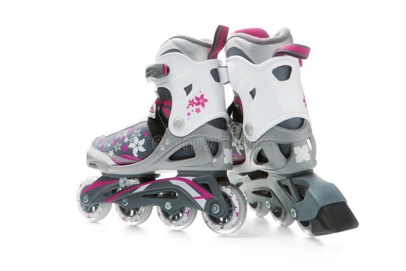 Inline skates. A pair of inline skates on white background stock photos