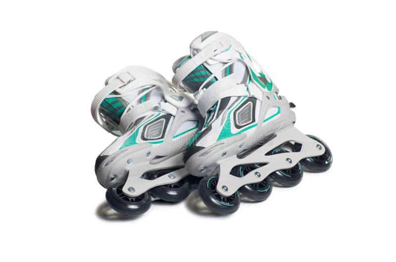 Inline skates. Isolated over white background stock photo