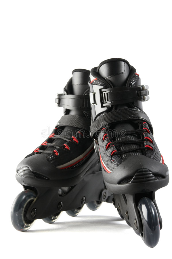Inline skates. A pair of inline skates on white background with clipping path stock images