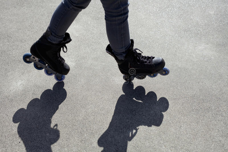 Inline Skating Balancing Act. With shadow composition royalty free stock photos