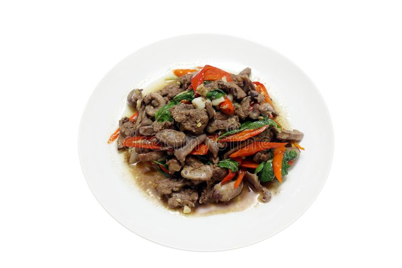Chicken innards Fried in oyster sauce, spicy food, chili food, Fried vegetable, Fried beef with oyster sauce & Basil leaves on top royalty free stock image