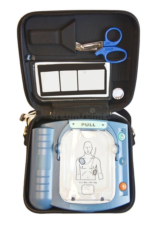 Innehåll av en AED, första hjälpask royaltyfri fotografi