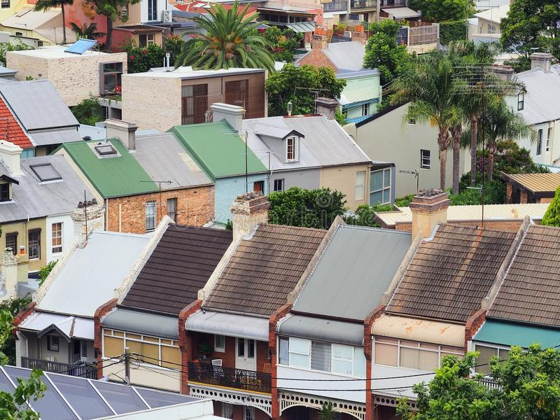 Inner City Terrace Houses. Inner city terrace, attached, row, houses, tiled and corrugated iron roofs royalty free stock image