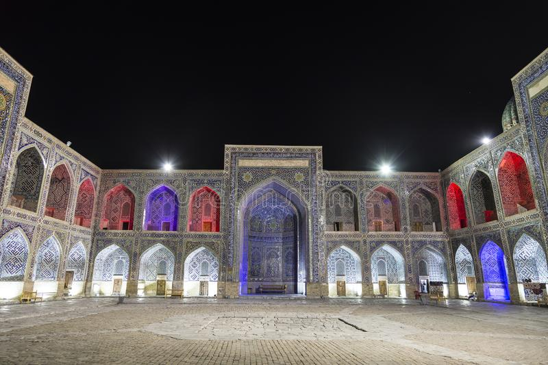 Inner court of the Sherdor madrasah on Registan square in Samarkand at night. Uzbekistan royalty free stock images