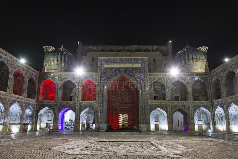 Inner court of the Sherdor madrasah on Registan square in Samarkand at night. Uzbekistan royalty free stock photo