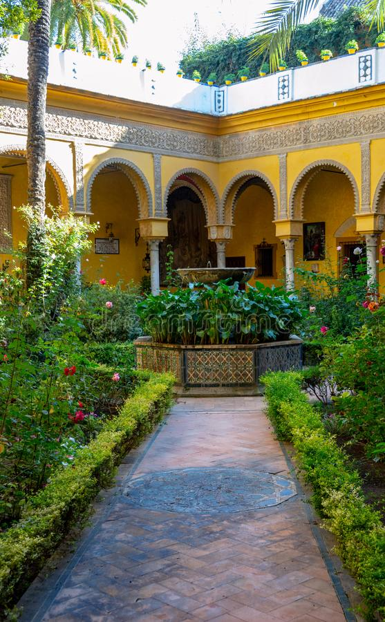 Inner courtyard in Real Alcazar in Seville, Spain royalty free stock photos