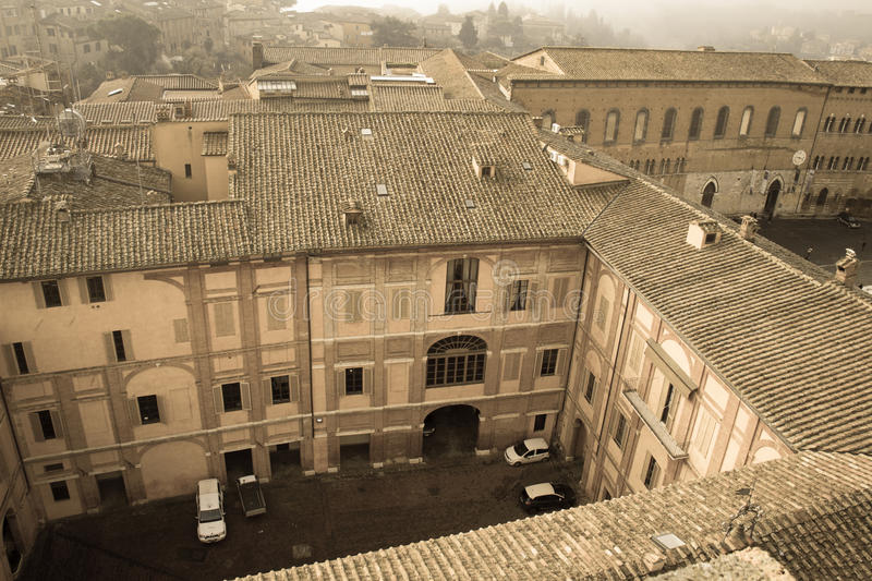 Inner courtyard of Santa Maria della Scala. Siena, Tuscany, Italy. Old polar effect. stock photography