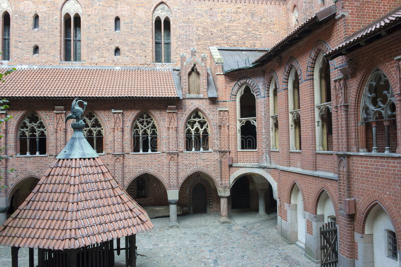 Inner Court of Malbork Castle near Gdansk, Poland. Medieval Castle Marienburg of the Teutonic Knights. View to inner Courtyard of medieval Castle of the Teutonic royalty free stock photography