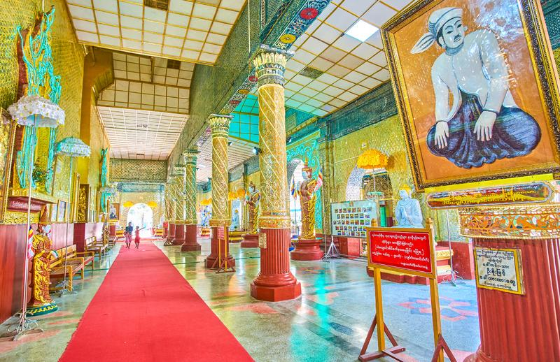 The inner gallery of Kyauktawgyi Buddha Temple in Mandalay, Myanmar royalty free stock image