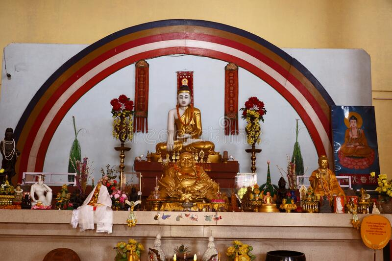 Hinayana Buddha temple, Sarnath. Inner view of the Thai Temple, the Hinayana Buddha temple at Sarnath with the statue of Lord Buddha & others stock image