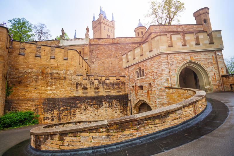 The inner yard of beautiful Hohenzollern castle. Entrance gates of beautiful Hohenzollern castle during summer day time in Germany royalty free stock images