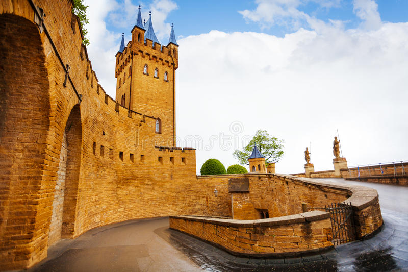 Inner yard of Hohenzollern castle after rain. The path to the main gates of Hohenzollern castle after rain during summer day time in Germany royalty free stock photo