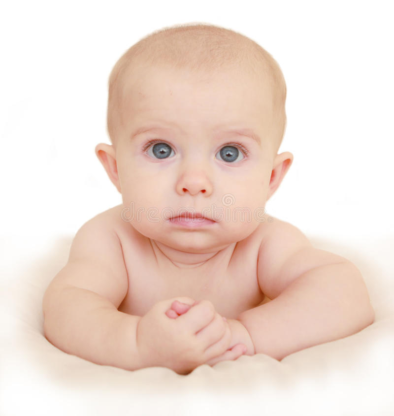 Innocent baby on the bed. Six month old baby on the bed stock image
