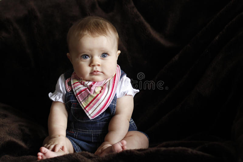 Innocent baby portrait with blue eyes stock photography