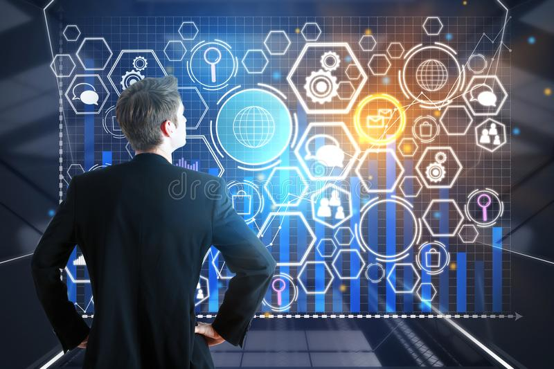 Innovation concept. Back view of young businessman looking at digital business screen. Innovation concept. Double exposure royalty free stock image
