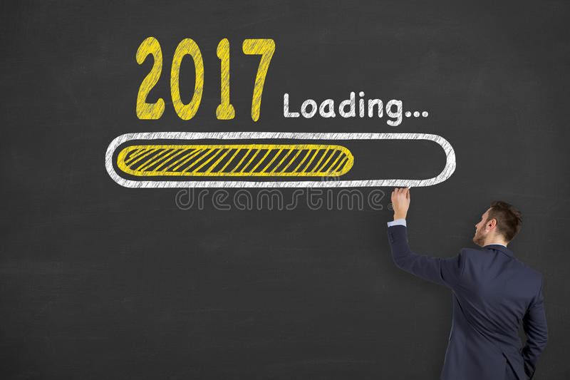 Innovation Concepts Loading New Year 2017 on Chalkboard Background stock images