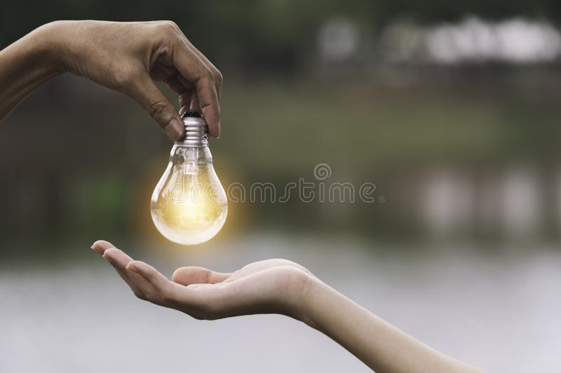 Innovation or creative concept of hand hold a light bulb and copy space for insert text stock image