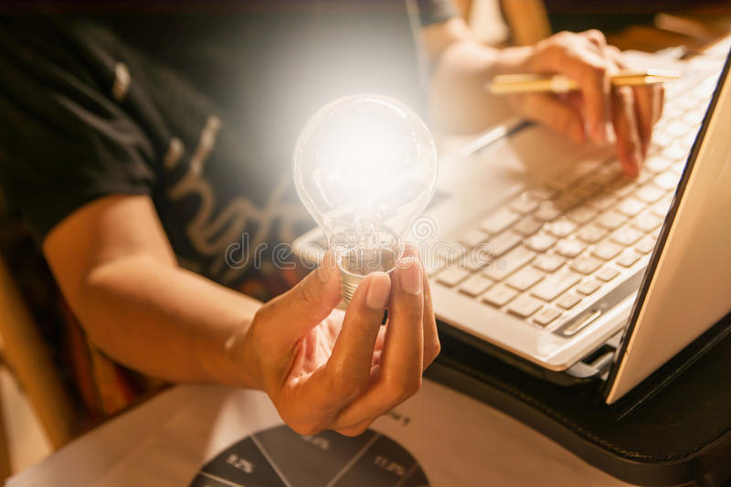 Innovation or creative concept of hand hold a light bulb with la royalty free stock photo