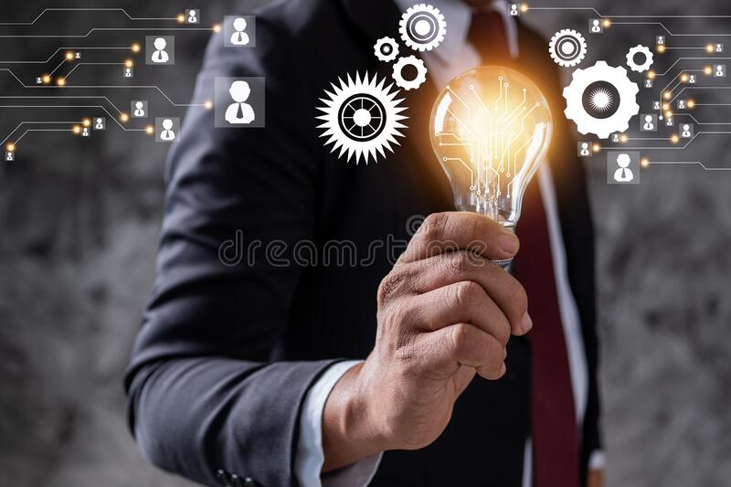 Innovation and idea of professional business leader holding lighting bulb,  thinking management and power of technology concept stock photo