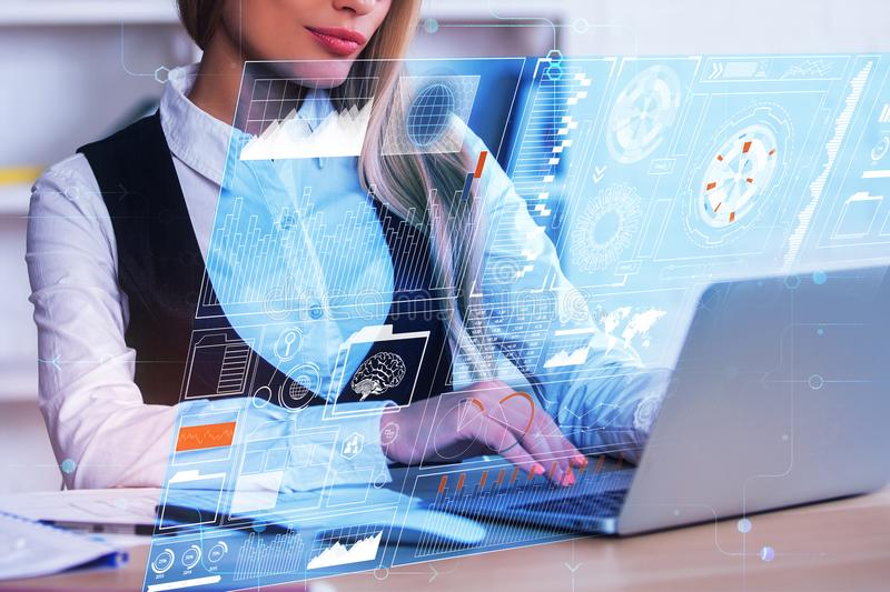 Innovation and media concept. Attractive young woman using laptop with abstract business hologram in modern office. Innovation and media concept. 3D Rendering royalty free stock images