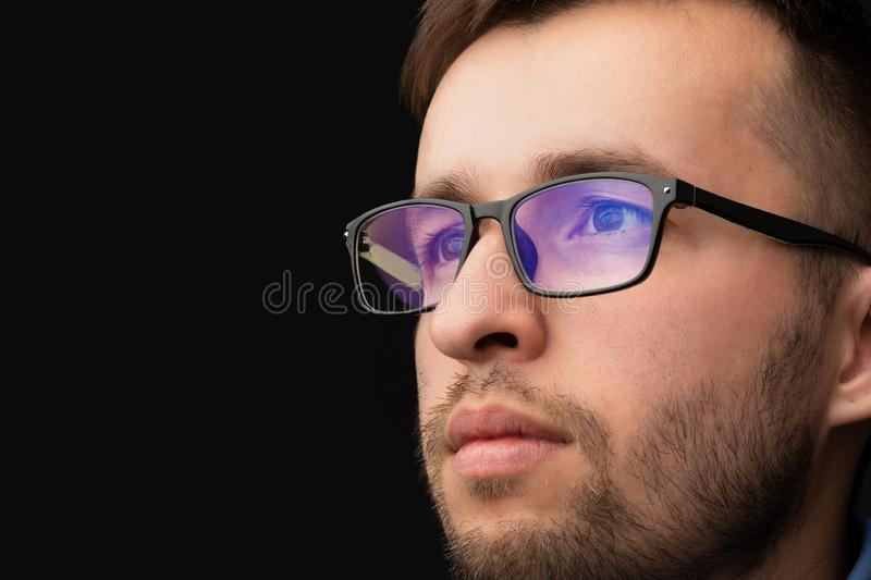 Young man looking with futuristic smart high tech glasses royalty free stock photography