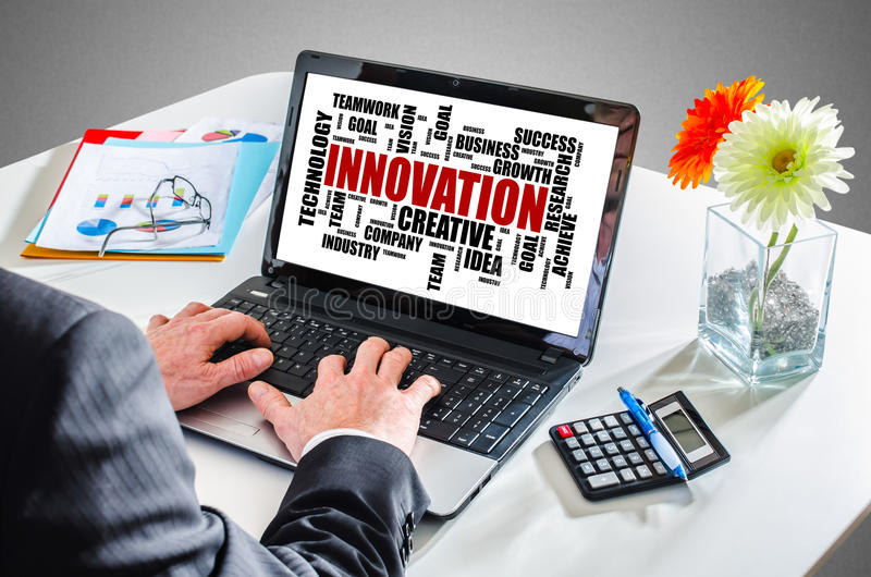 Innovation word cloud concept on a laptop screen stock image