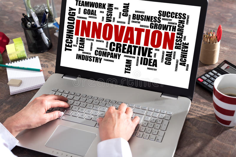 Innovation word cloud concept on a laptop screen royalty free stock image
