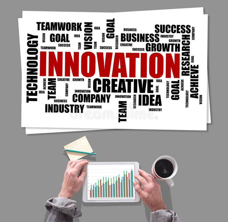 Innovation word cloud concept placed on a desk stock images